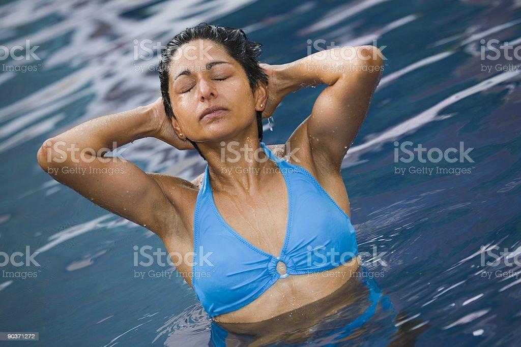 Asian woman in bikini swimming royalty-free stock photo