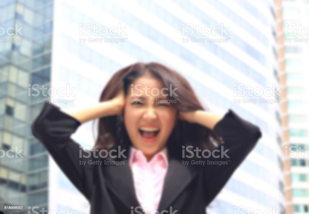 Asian woman in business suite with  angry face stock photo