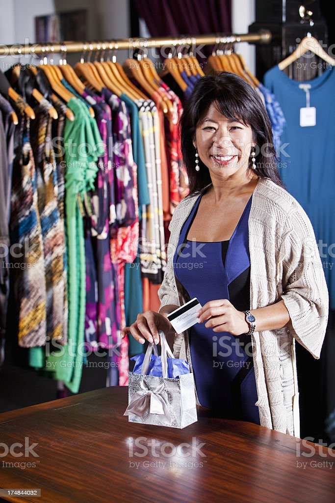 Asian woman in clothing store royalty-free stock photo