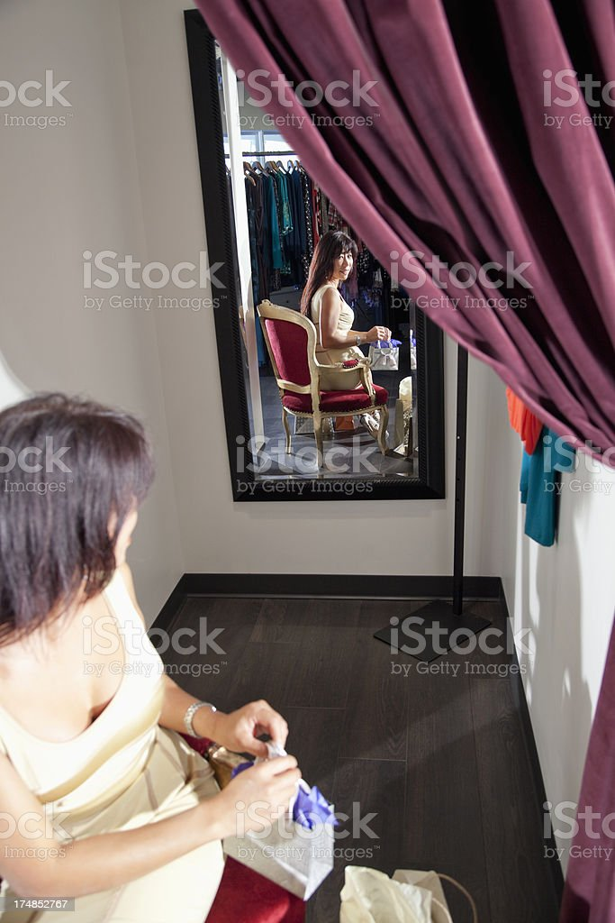 Asian woman in clothing store stock photo