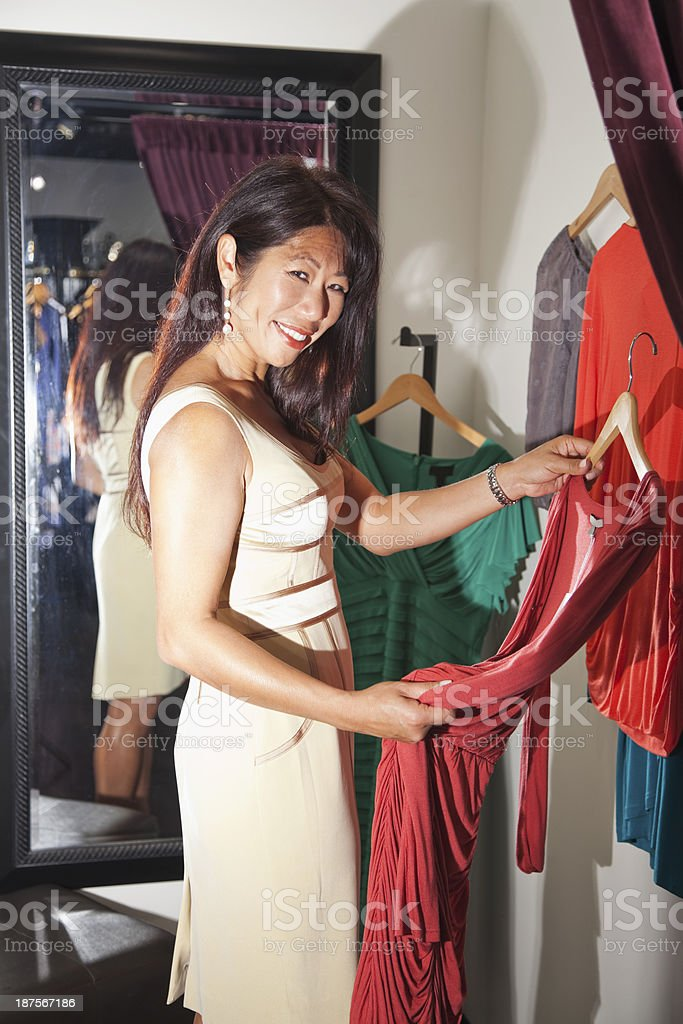 Asian woman in fitting room stock photo