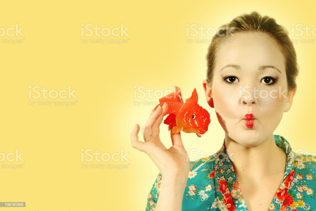 Asian Woman in Kimono Holding Plastic Goldfish royalty-free stock photo