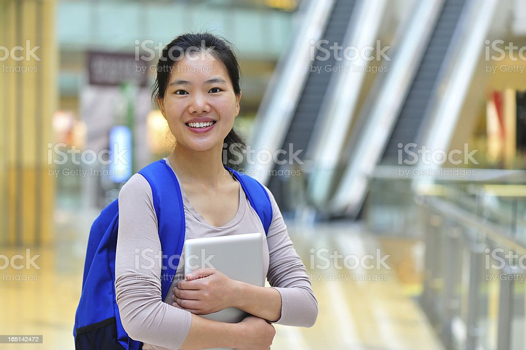 asian woman in modern shopping mall royalty-free stock photo