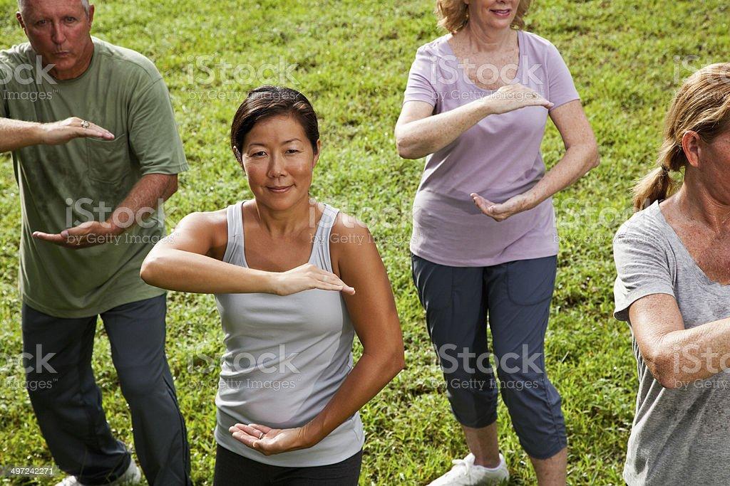 Asian woman in tai chi class stock photo