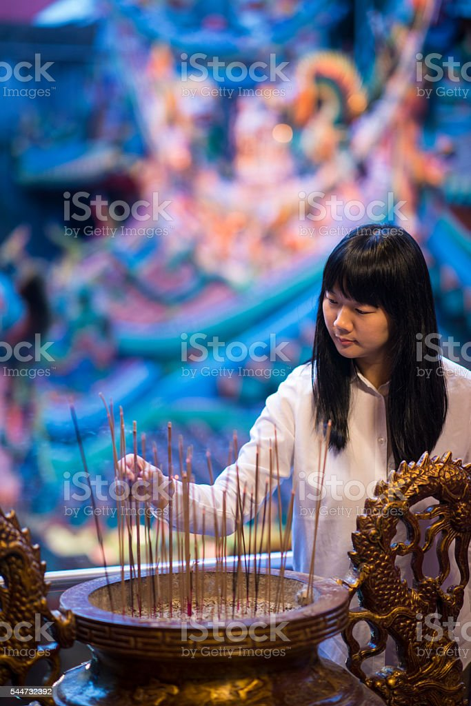 Asian woman in temple. stock photo