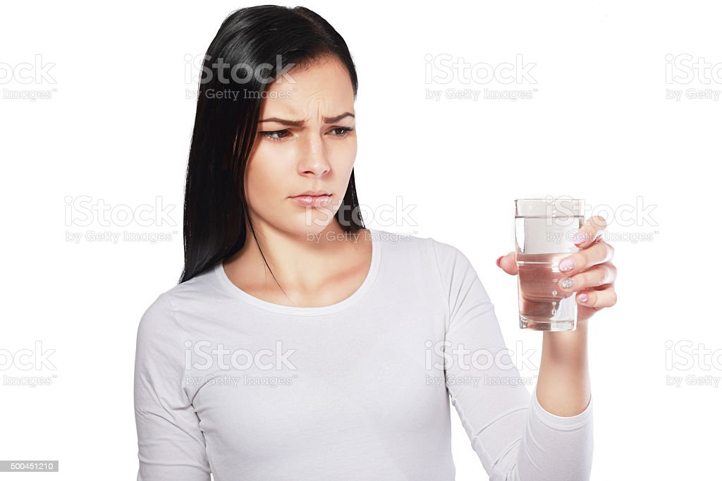 asian woman looking at water looking unhappy stock photo