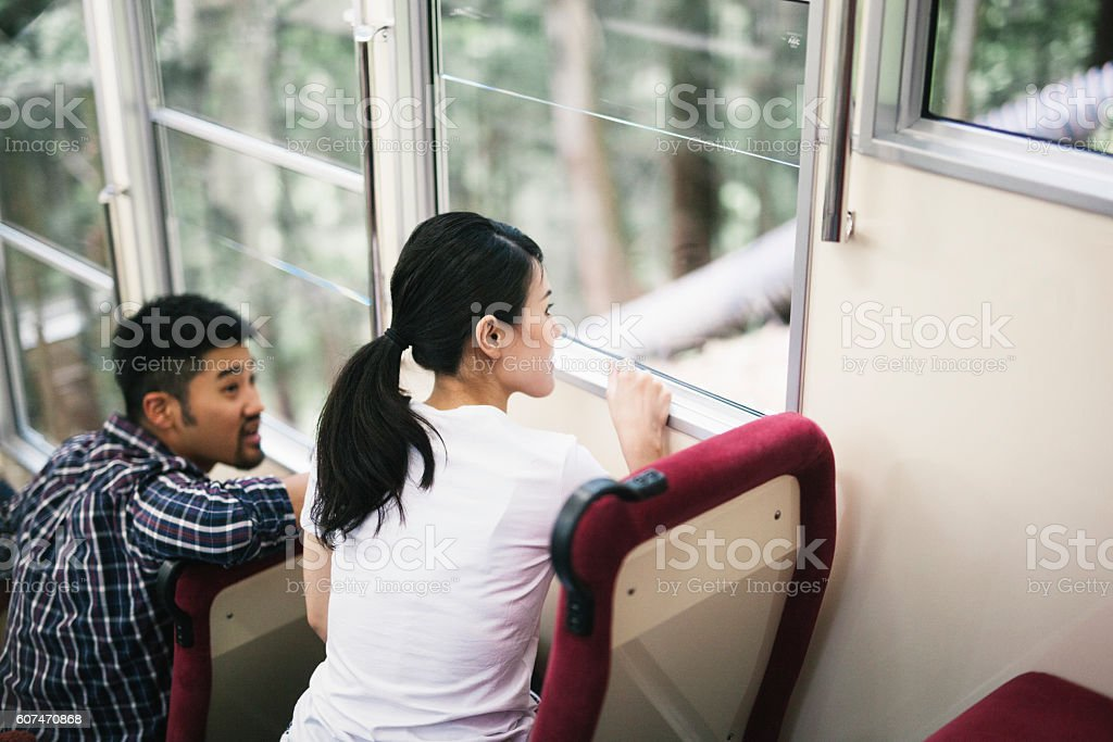 Asian Woman Looking Out of a Funicular Window stock photo