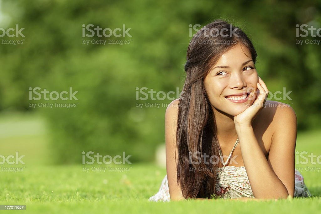 Asian woman lying in grass royalty-free stock photo