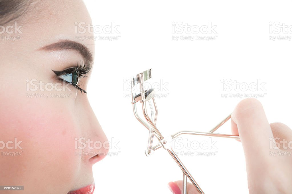 Asian woman making up in white background stock photo