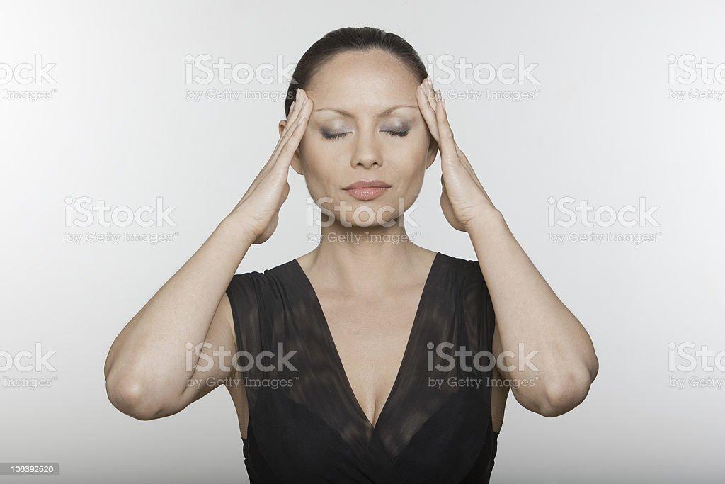 asian woman massaging her head stock photo