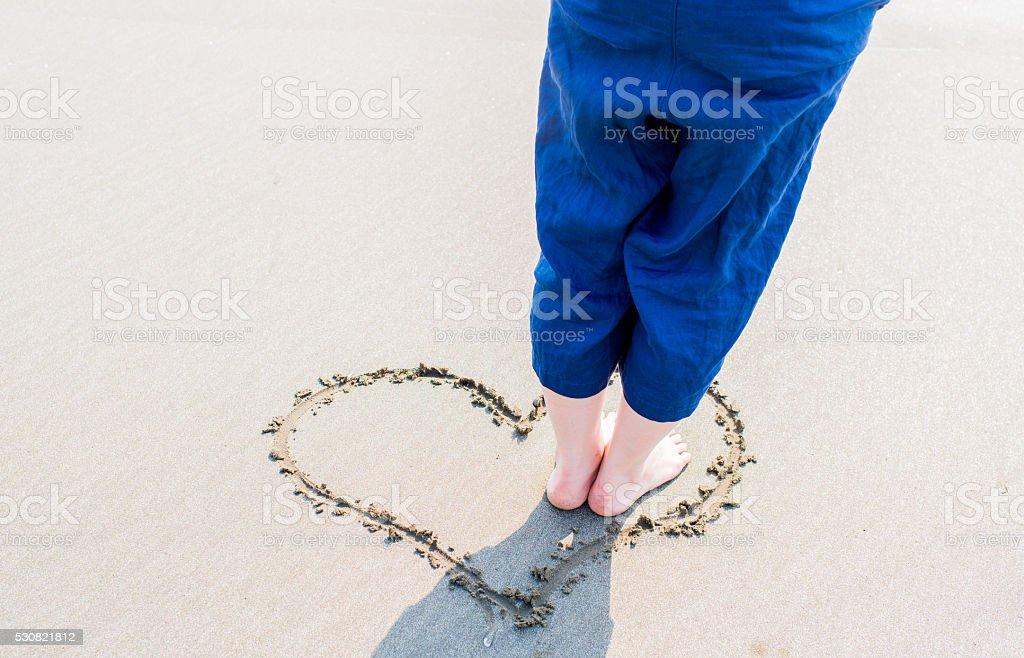 Asian woman on the beach stock photo
