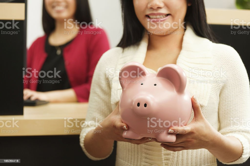 Asian Woman Opening Saving Account with Retail Bank Teller Hz royalty-free stock photo