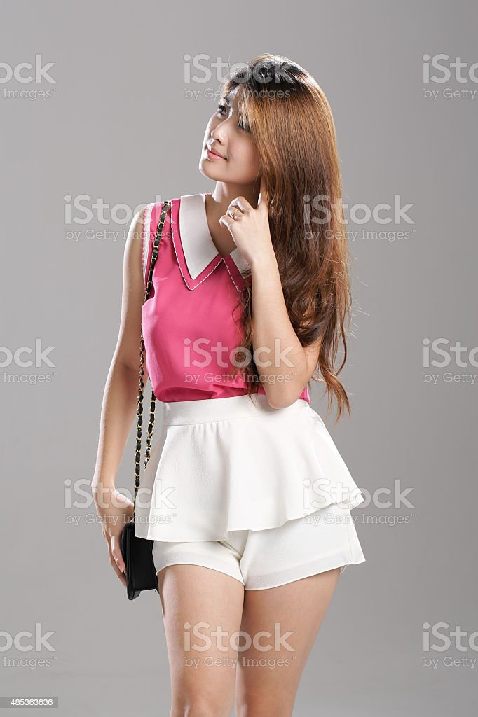 Asian woman Pink Sleeveless-Double-Layer Collar-Tank Tops,  white double-layer flutter skort stock photo