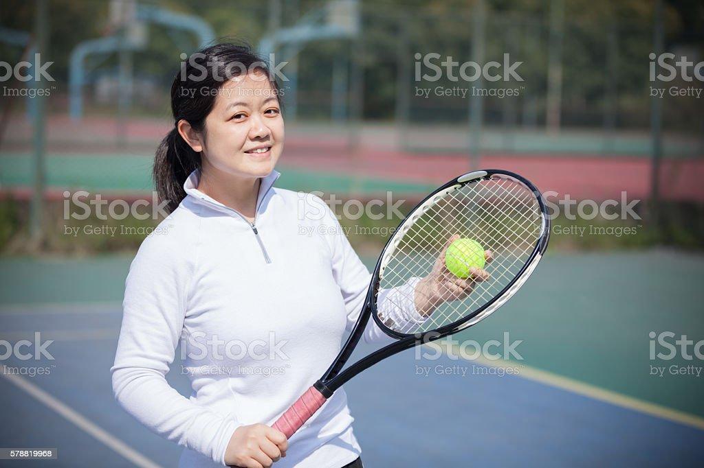 Asian woman play tennis stock photo