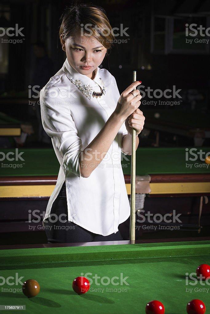 asian woman playing pool royalty-free stock photo