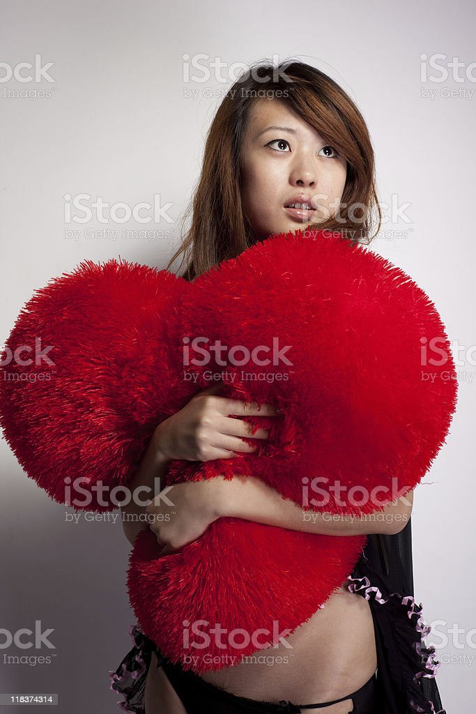 Asian woman posing over a wall stock photo