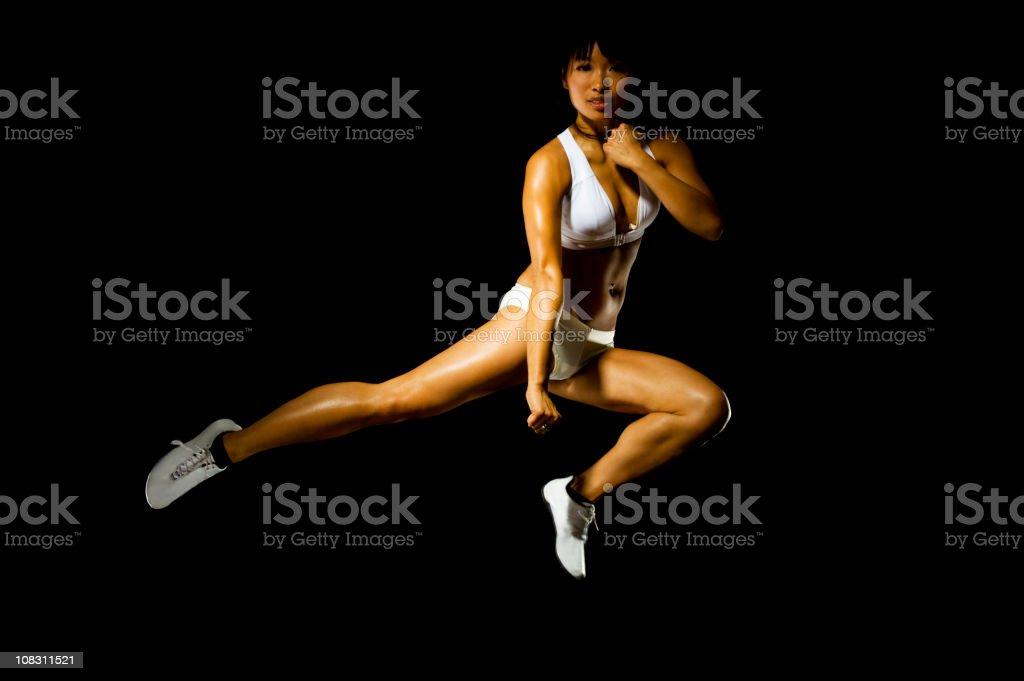 Asian woman practicing martial arts stock photo