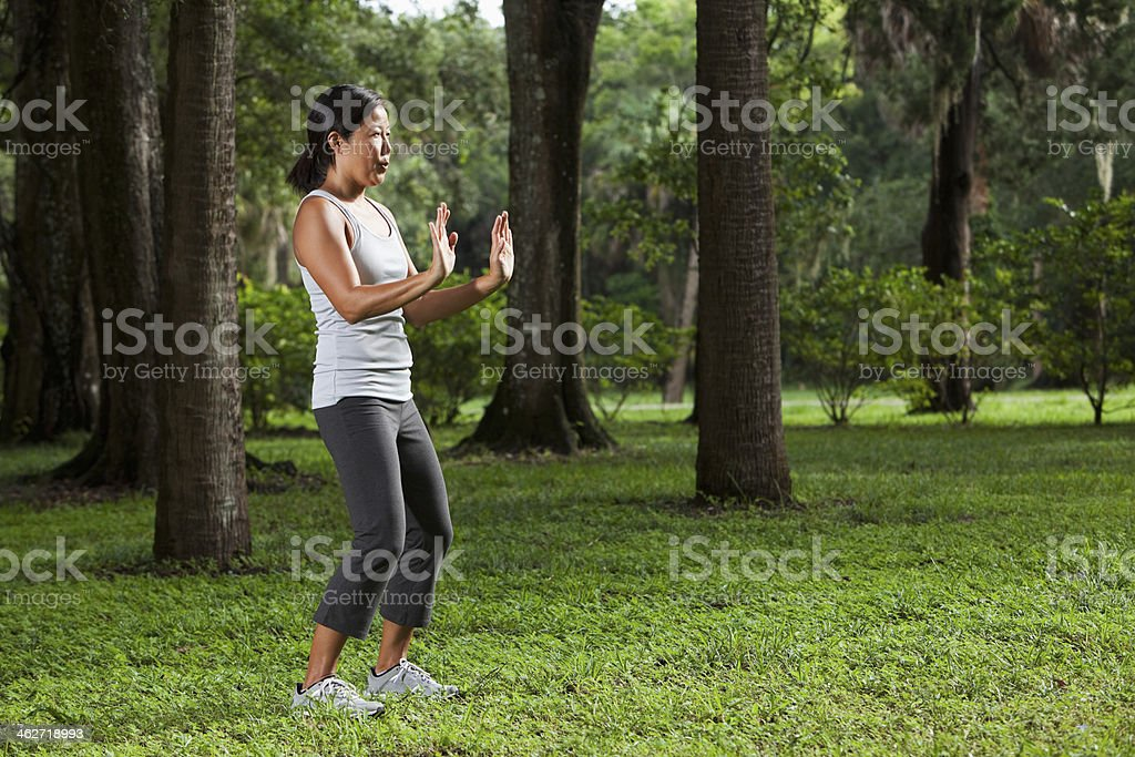 Asian woman practicing tai chi stock photo