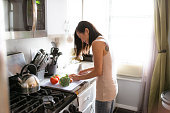asian woman preparing food on the kitchen