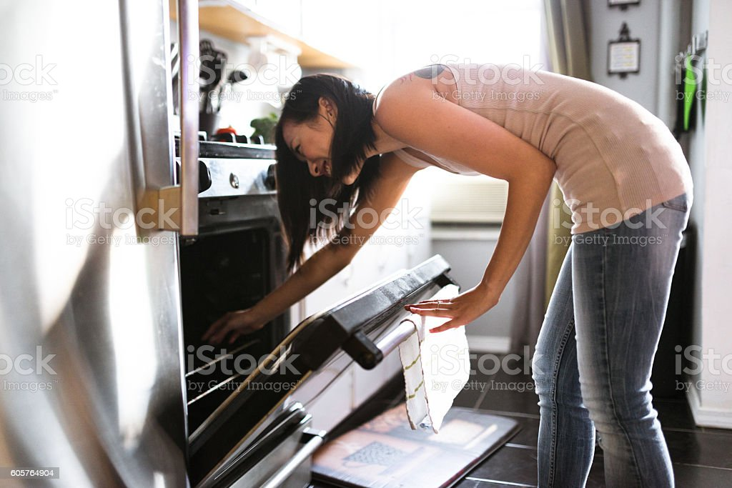 asian woman preparing food on the kitchen stock photo