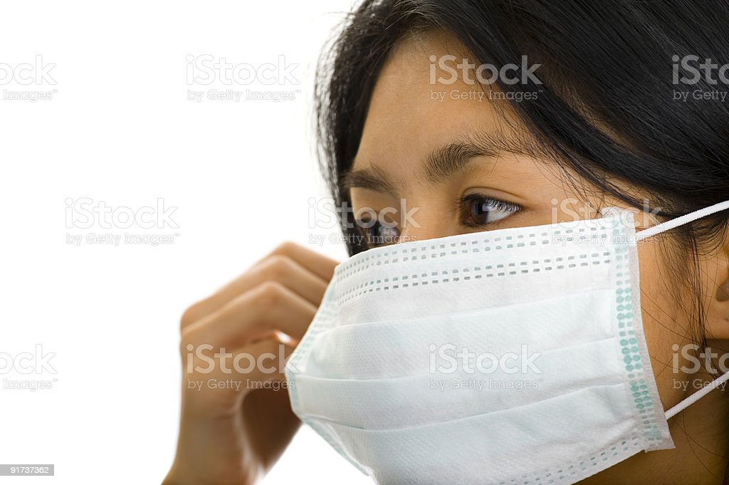 asian woman putting on a face mask stock photo