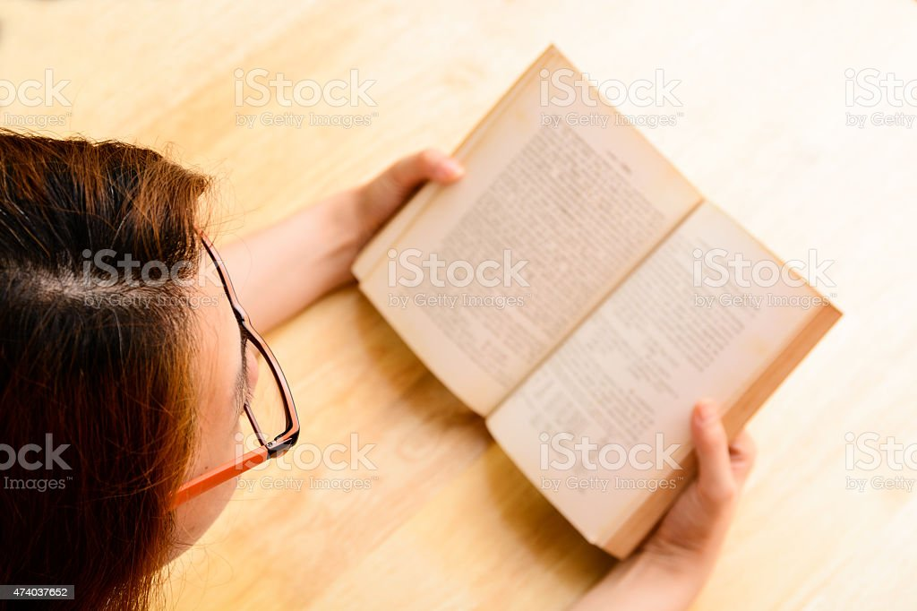 Asian woman reading book stock photo