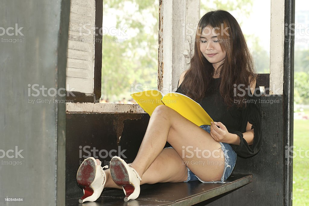 Asian woman reading in old train room . royalty-free stock photo