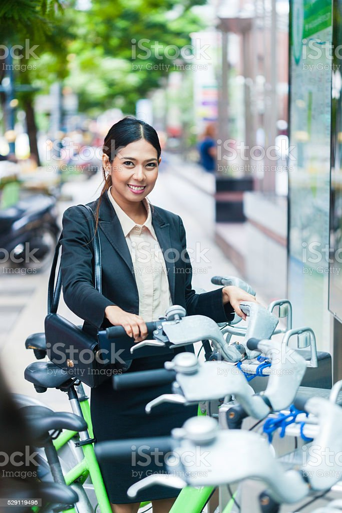 Asian woman ready to rent a bicycle in Bangkok stock photo