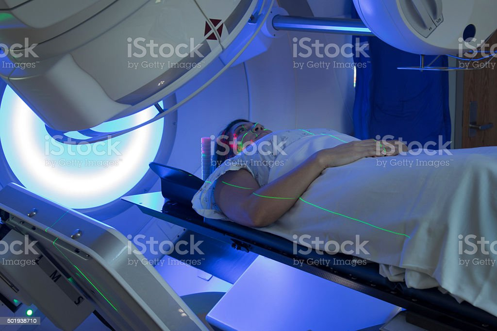 Asian Woman receiving Radiation Therapy Treatments for Cancer stock photo