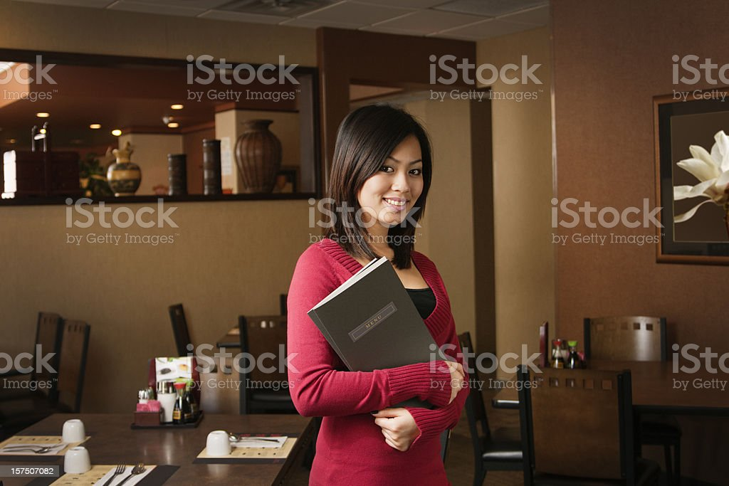 Asian Woman Restaurant Small Business Owner, Host or Maitre D stock photo
