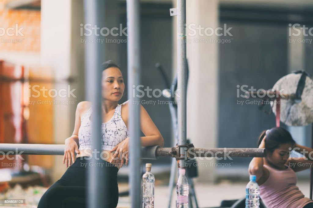 Asian woman resting in the urban gym stock photo