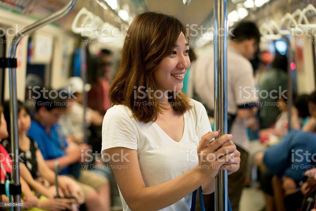 Asian woman riding the metro stock photo