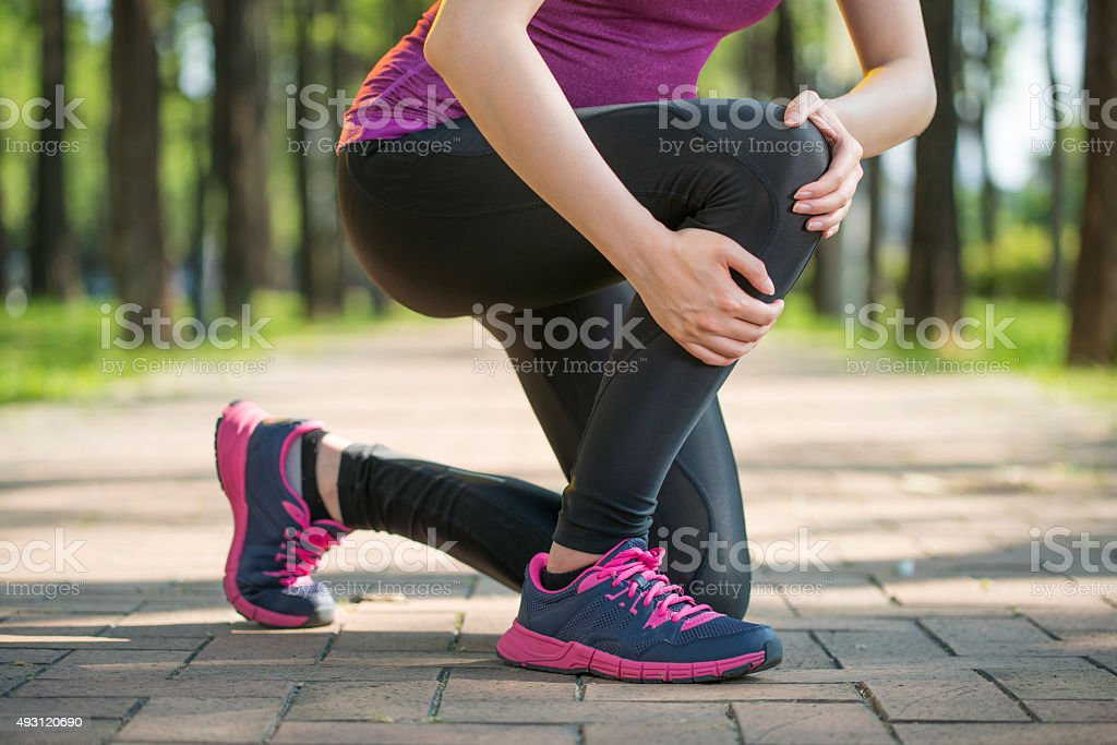 Asian woman runner hold Knee Pain ,Human Leg stock photo