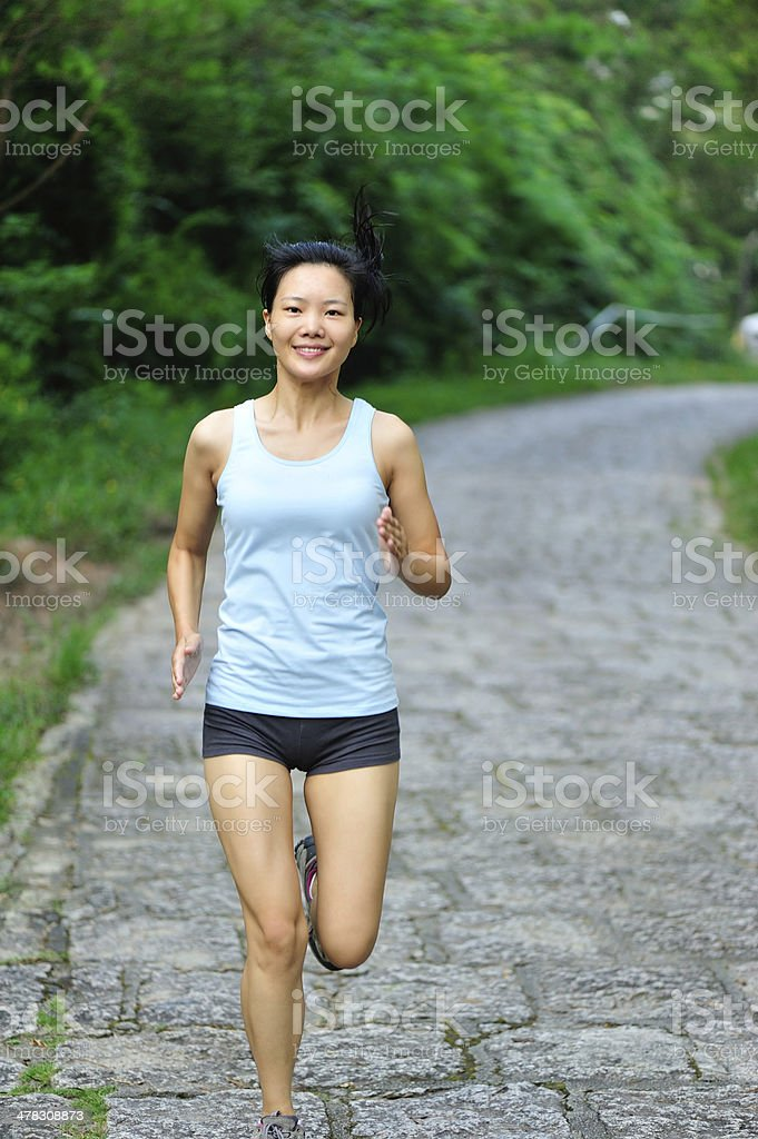asian woman runner running outdoor in the morning royalty-free stock photo