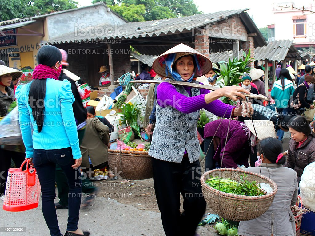 Asian woman selling vegetables at the market stock photo