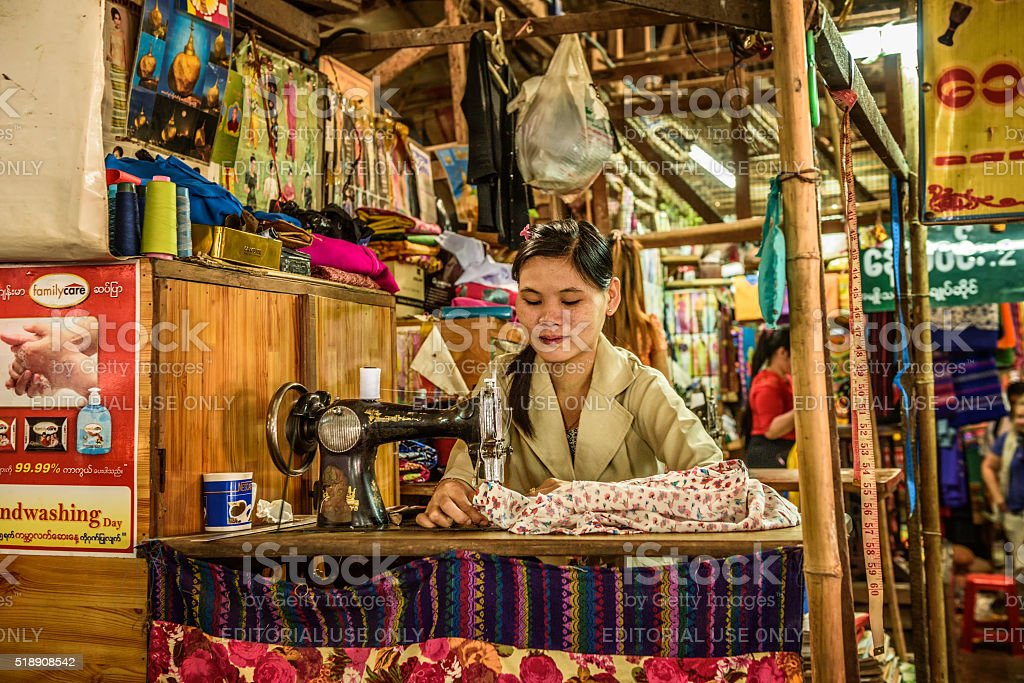 Asian woman sewing in Yangon, Myanmar stock photo