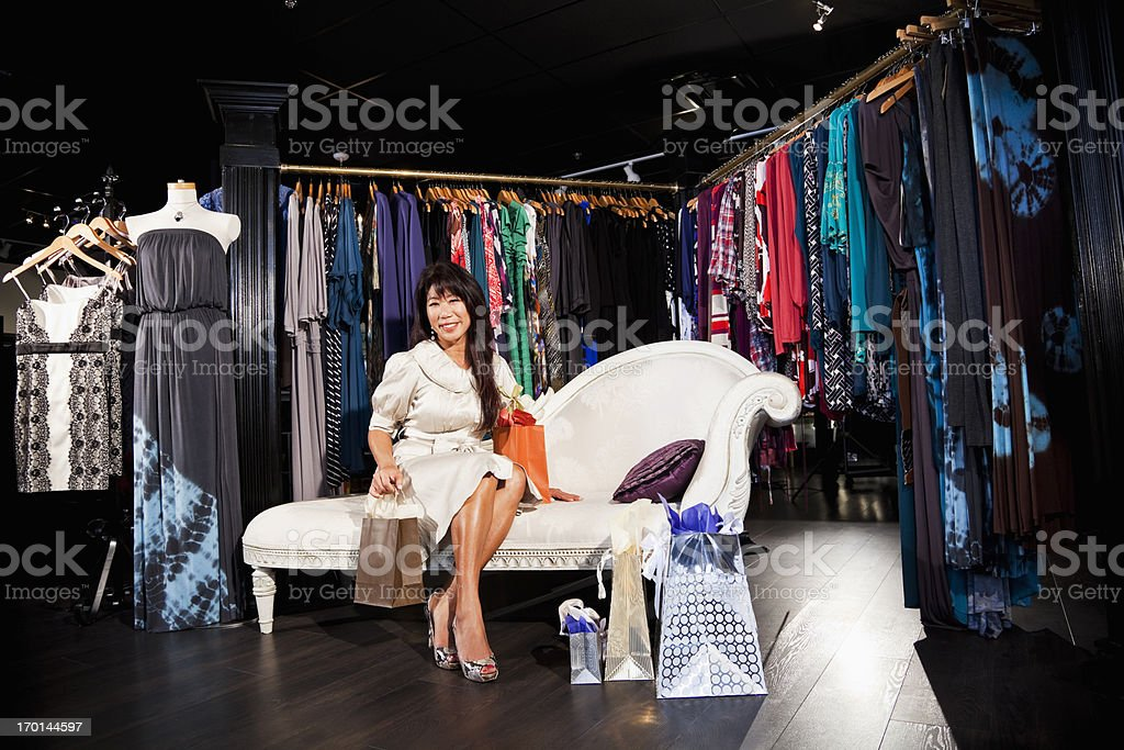 Asian woman shopping for clothing royalty-free stock photo