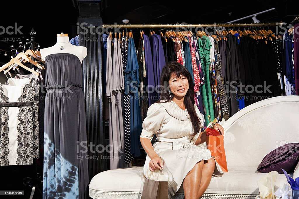 Asian woman shopping for clothing stock photo