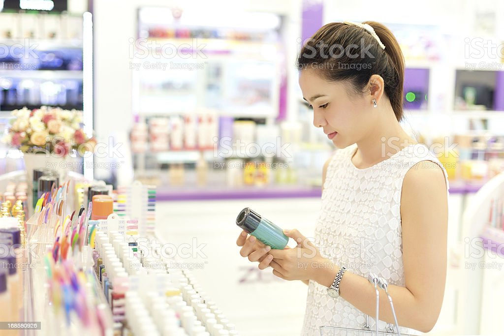 Asian woman shopping in the store cosmetics. stock photo