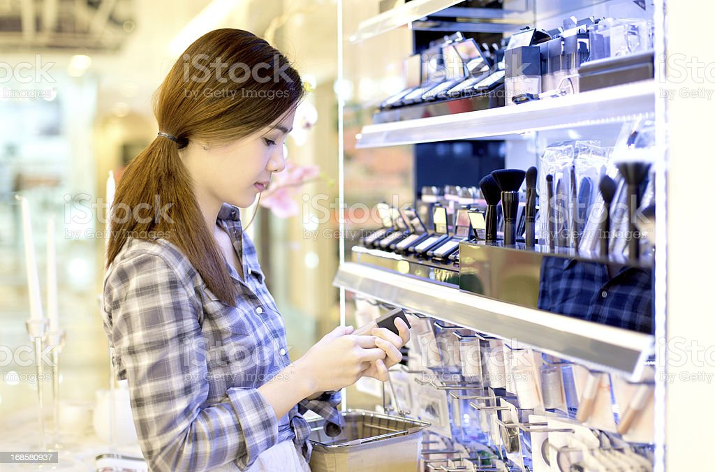 Asian woman shopping in the store cosmetics.. royalty-free stock photo