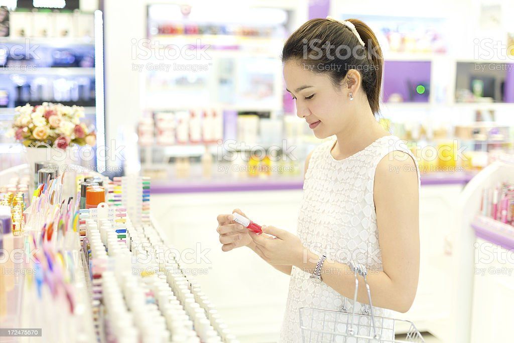 Asian woman shopping in the store cosmetics stock photo