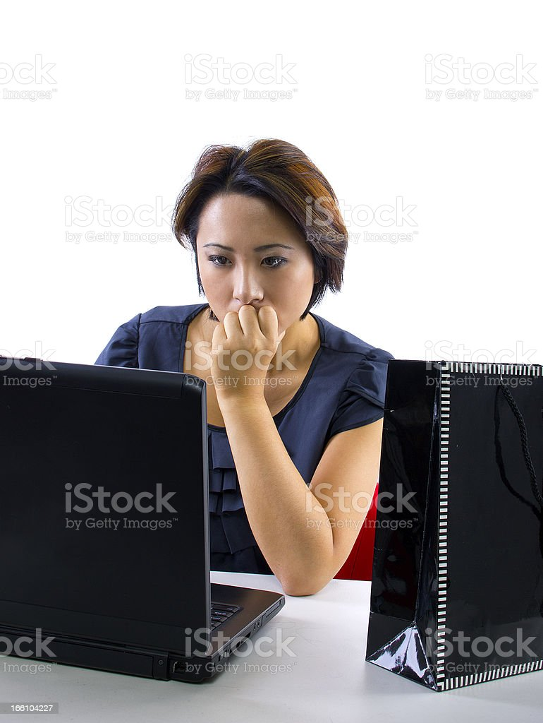 Asian Woman Shopping Online ona Computer Overspending royalty-free stock photo