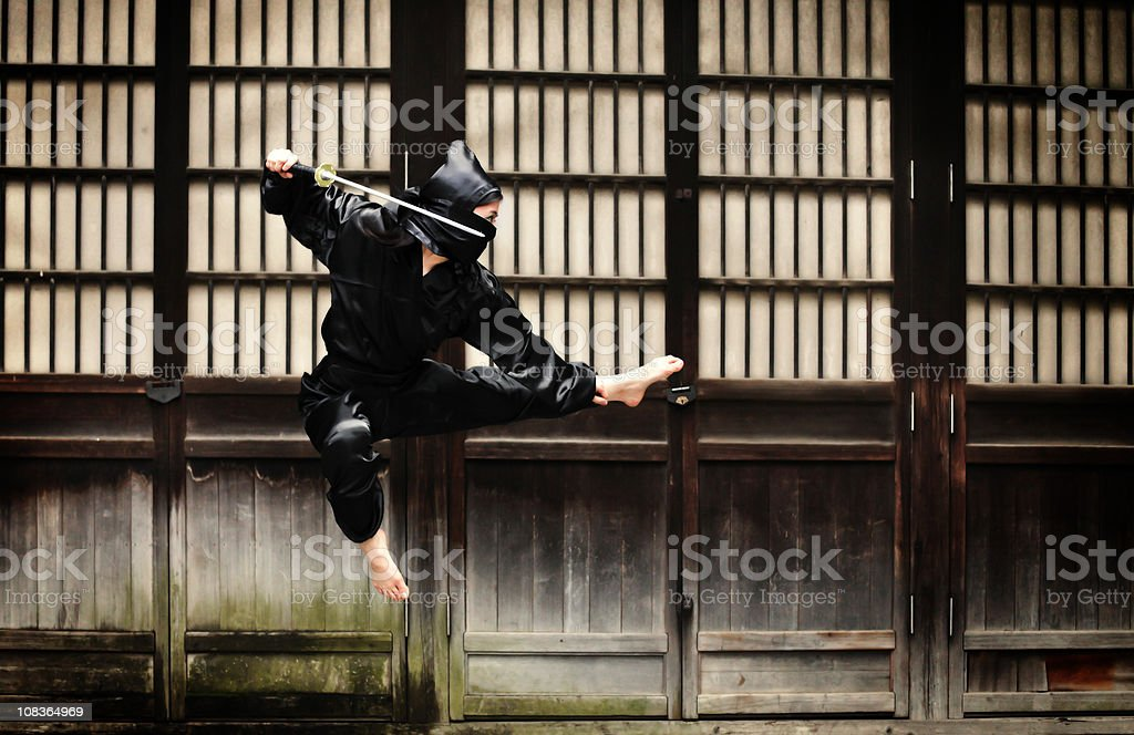 Asian woman showing her ninja moves royalty-free stock photo