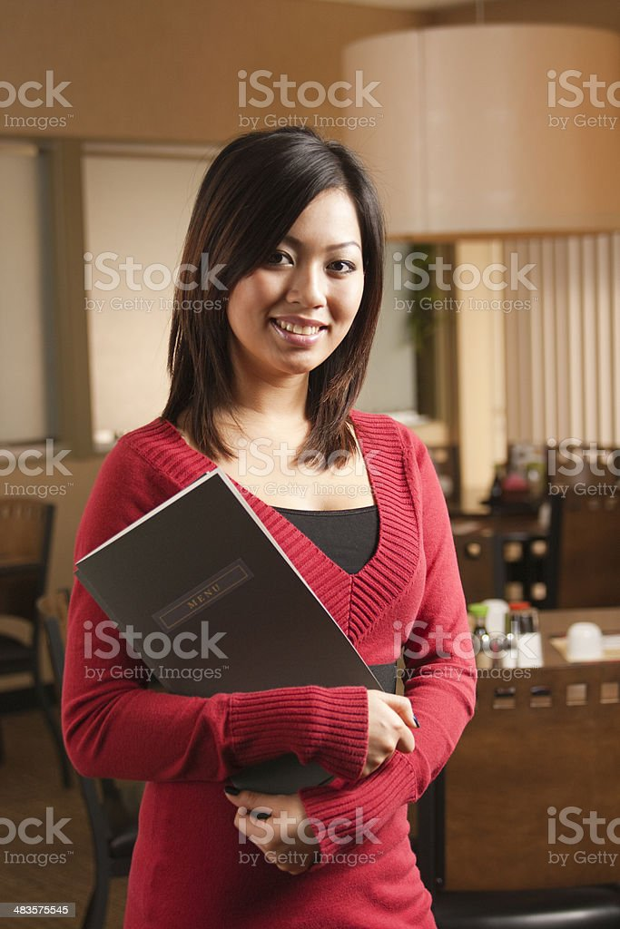 Asian Woman, Small Business Owner or Restaurant Host Maitre D stock photo