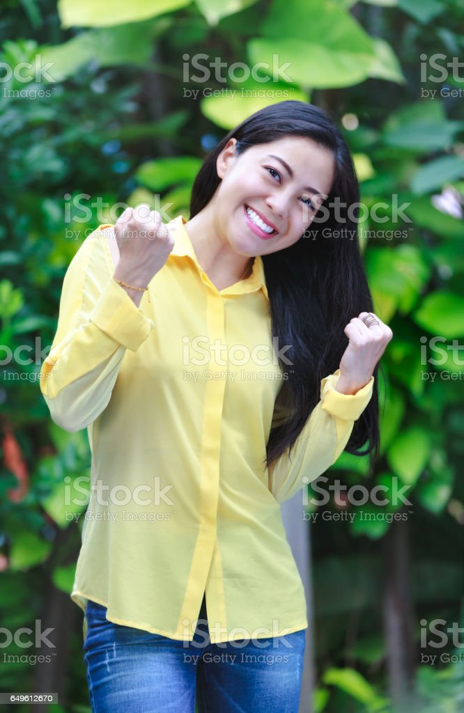 Asian woman smiling happy. Action of winner or successful people. stock photo