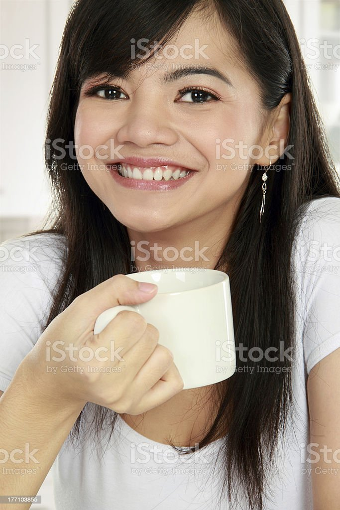 asian woman smiling having coffee royalty-free stock photo