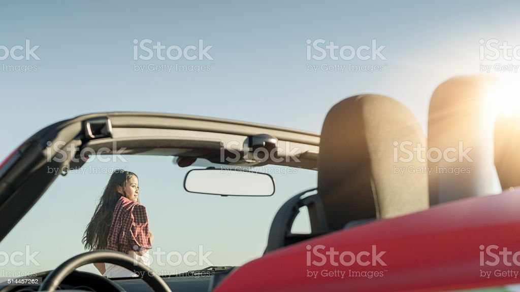 asian woman   standing with cabriolet stock photo