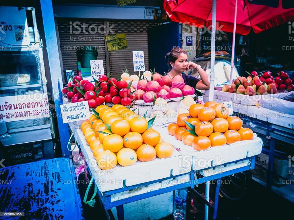 Asian Woman Street Food Vendor, Fruit Stall stock photo