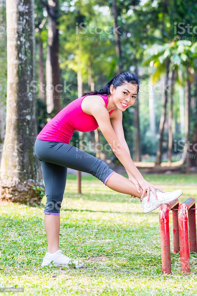 Asian Woman stretching in fitness exercise stock photo