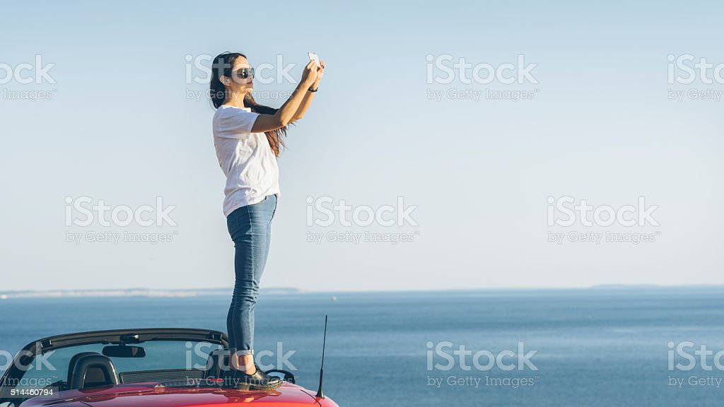 asian woman  taking picture with cellphone stock photo